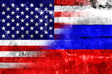 USA and Russia Flag painted on grunge wall
