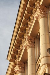 Fragment of neoclassic building with columns and fine capitals.