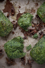 spinach plum cake and anise on spotted paper
