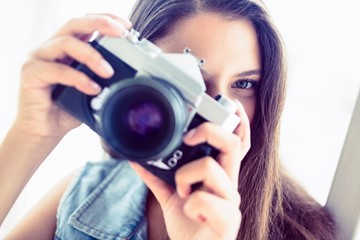 Brunette woman taking a photo