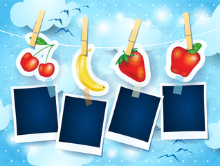 Fruits and photo frames on sky background
