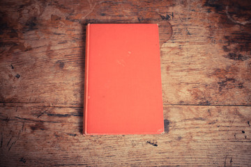 Red book on a wood table