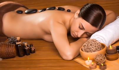 beautiful brunette in a massage parlor - fototapety na wymiar