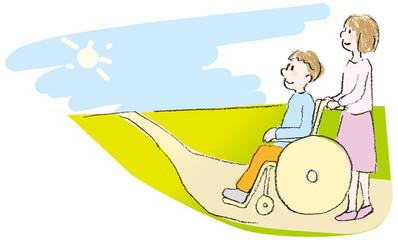 車いすの人と介助者