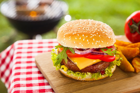 Tasty cheeseburger with melted cheddar
