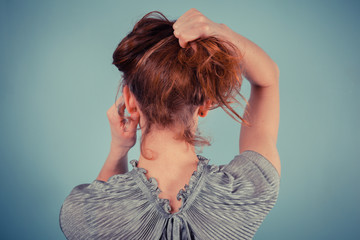 Young woman adjusting her hair