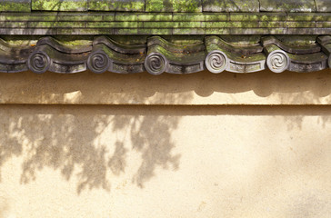 Wall with old tiled roof