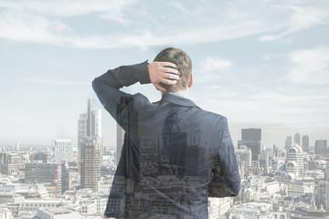 Businessman looking at skyline