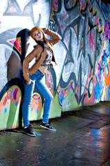Pretty young girl and graffiti
