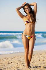 Sexy and beautiful woman posing in bikini