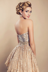 beautiful blond woman in elegant beige dress