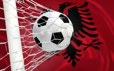 Flag of Albania and soccer ball in goal net