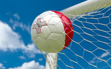 Flag of Malta and soccer ball in goal net