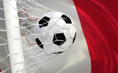 Flag of Malta and soccer ball in goal net