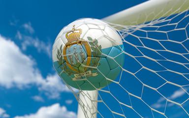 Flag of San Marino and soccer ball in goal net