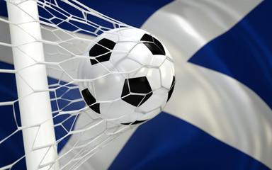 Flag of Scotland and soccer ball in goal net