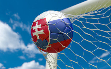 Flag of Slovakia and soccer ball in goal net