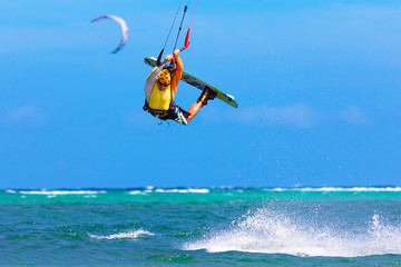 young kitesurfer on sea background Extreme Sport Kitesurfing