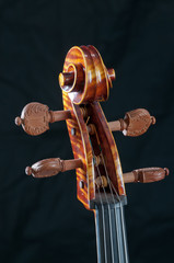 Close-up of the head or tuning workmanship on a beautiful cello