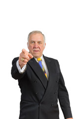 older businessman in a suit and tie pointing towards the viewer over a white background