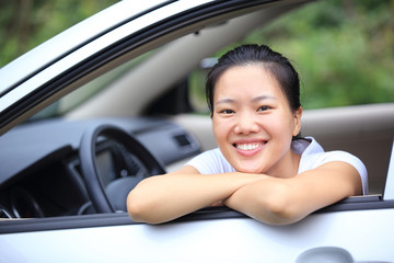 happy woman driver in her car