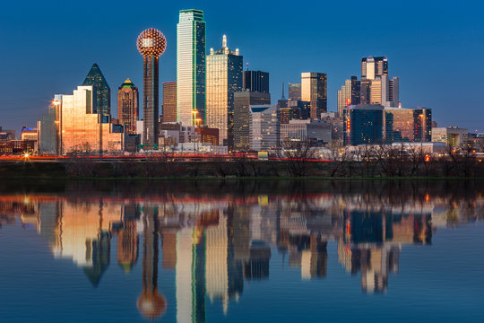 Dallas skyline reflected in Trinity River at sunset