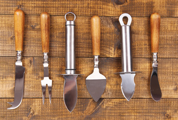 Set of knives on wooden table close-up