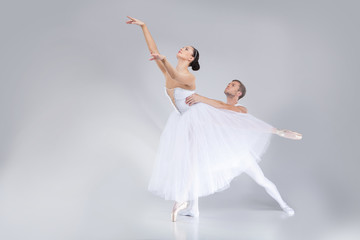 two young ballet dancers practicing.