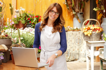 Florist working on laptop