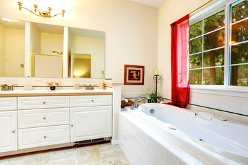 Cozy ivory bathroom with a french window and red curtains