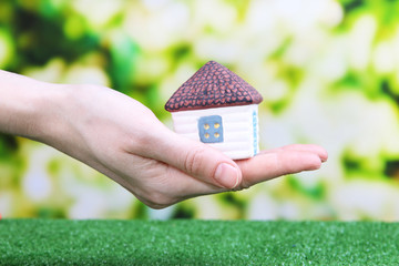 Little paper house in hand close-up,