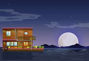 A boathouse floating in the middle of the night