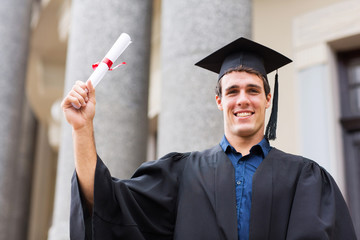 male university student holding his graduation certificate