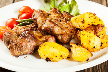 Grilled steaks and baked potatoes