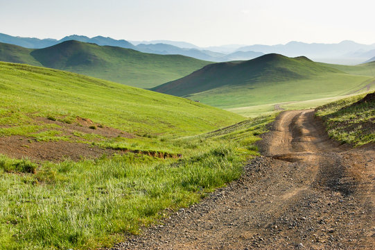 Winding dirt road through Central Mongolian steppe