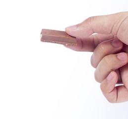 Hand hold three pieces of chocolate