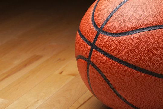 Basketball shot close up on hardwood gym floor