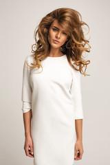 Beautiful model posing in white dress