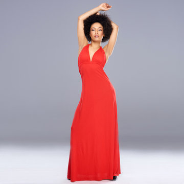 Graceful African American woman in a red gown