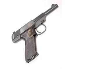 Small 22 caliber handgun.Isolated on white background.