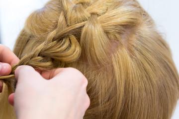 Hairdresser make braids