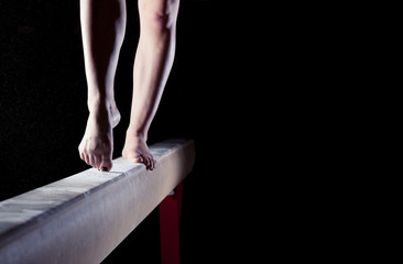 Foto op Plexiglas Gymnastiek feet of gymnast on balance beam