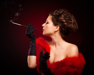 Retro Woman Portrait. Beautiful Woman with Mouthpiece in luxury