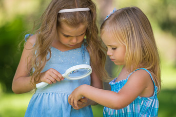 Children with a magnifying glass