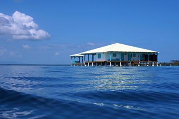 Caribbean house on stilts over the sea