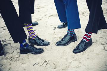 Groomsmen and groom's feet