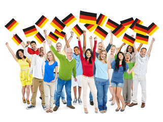 Multi-Ethnic Group of Diverse Happy People Waving German Flag