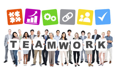 Group Of Diverse People Holding The Word Teamwork