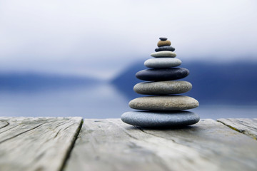 Zen Balancing Pebbles Next to a Misty Lake Fototapete