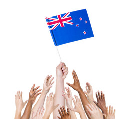 Diverse People Holding The Flag of New Zealand